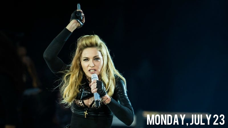 Illustration for article titled Madonna Tastelessly Waves Guns Around Onstage Post-Aurora Shooting