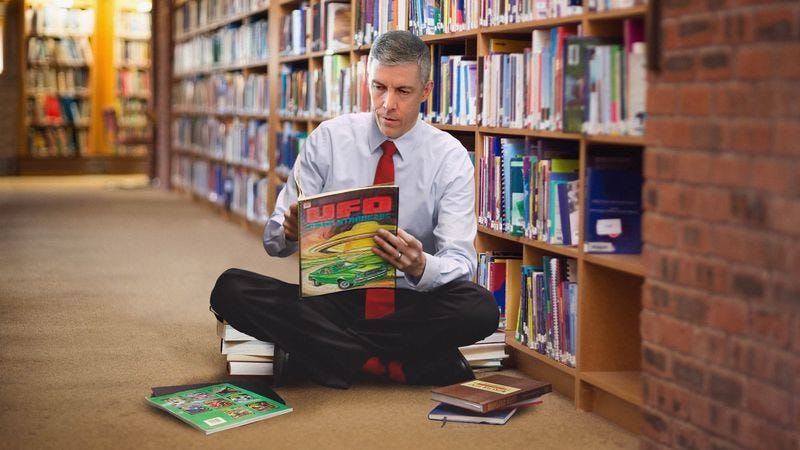 Illustration for article titled Arne Duncan Spends Visit To Local Elementary School Looking At UFO Books In Library