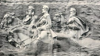 "Confederate leaders Jefferson Davis, Robert E. Lee and Thomas J. ""Stonewall"" Jackson are depicted on Stone Mountain.iStock"