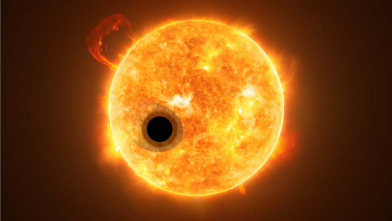 Artist's conception of exoplanet WASP-107b as it passes in front of its host star. The Jupiter-sized world features a distinctly comet-like tail.