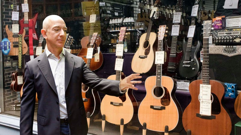 Illustration for article titled Daring To Dream: Jeff Bezos Is Standing Outside A Guitar Center Gazing Longingly At A $200 Billion Guitar