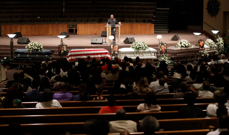 Bishop William Harris speaks during the funeral for Horace Coleman, Belinda Coleman, Irvin Coleman, Angela Coleman and Maxwell Coleman Ly, Saturday, July 28, 2018, in Indianapolis. Nine members of the Coleman family were killed in a duck boat accident at Table Rock Lake near Branson, Mo.