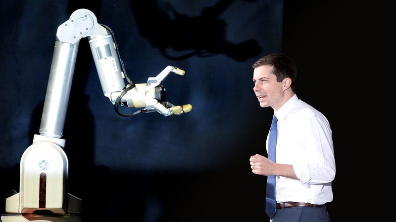 Illustration for article titled Pete Buttigieg Stuns Campaign Crowd By Speaking To Manufacturing Robots In Fluent Binary
