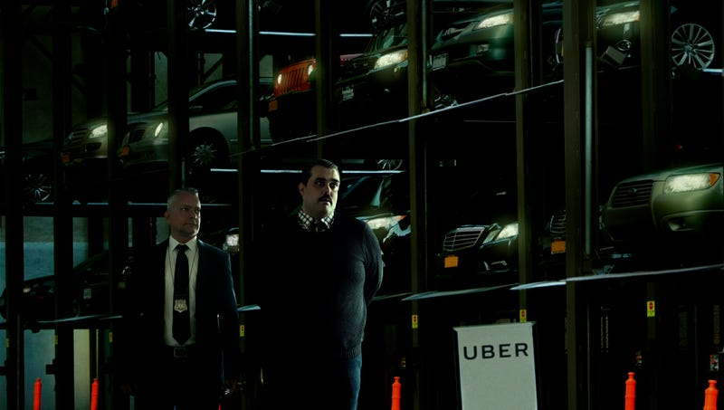 Illustration for article titled 'As You Can See, They Are Quite Harmless,' Says Uber Representative Guiding Detective Through Warehouse Of Sleeping Autonomous Cars