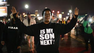 Demonstrators protest in front of the police station in Ferguson, Mo., March 12, 2015, in the aftermath of the fatal police shooting of Michael Brown. Scott Olson/Getty Images