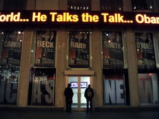 Tourists stand outside of Fox News. (Getty Images)