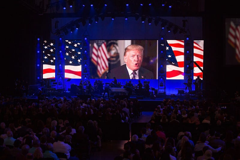 President Donald Trump addresses the audience during the Deep From the Heart: The One America Appeal Concert at Reed Arena at Texas A&M University in College Station on Oct. 21, 2017. (Rick Kern/Getty Images for Ford Motor Co.)