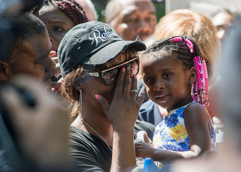 Diamond Reynolds, holding her daughter, speaks to a crowd outside the Governor's Mansion on July 7, 2016, in St. Paul, Minn. Stephen Maturen/Getty Images