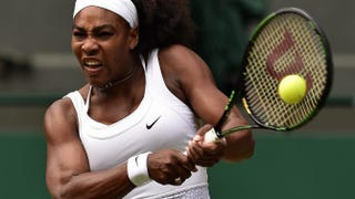 Serena Williams returns against sister Venus Williams during their women's singles fourth-round match on day 7 of the 2015 Wimbledon Championships at the All England Tennis Club in southwest London on July 6, 2015. LEON NEAL/AFP/Getty Images