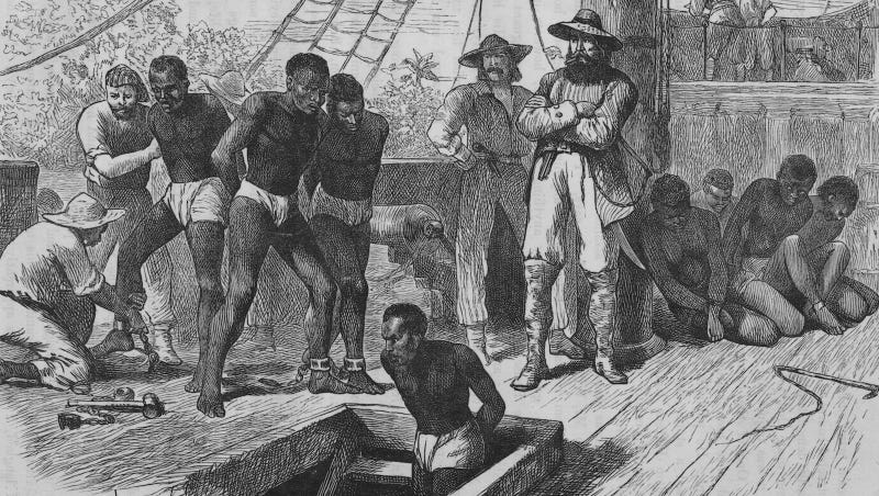 Kidnapped men aboard a slave ship before being shackled and put in the hold, ca. 1835. Image via Getty.