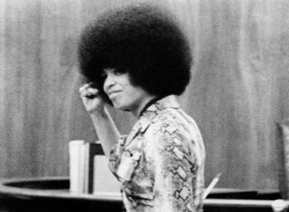 Photo released on April 2, 1971, of Angela Davis raising her fist in court during her 1970 trial in San Rafael, Calif.AFP/Getty Images