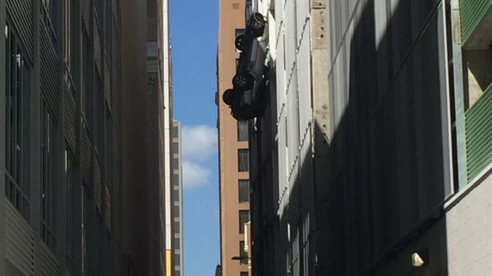 here s video of that car falling seven stories out of a parking what it s like to be in a car dangling off the ninth floor of a parking garage