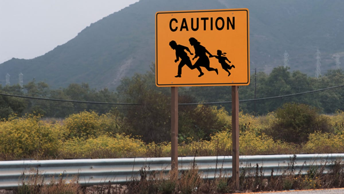 Image result for yellow road sign warning about running immigrants