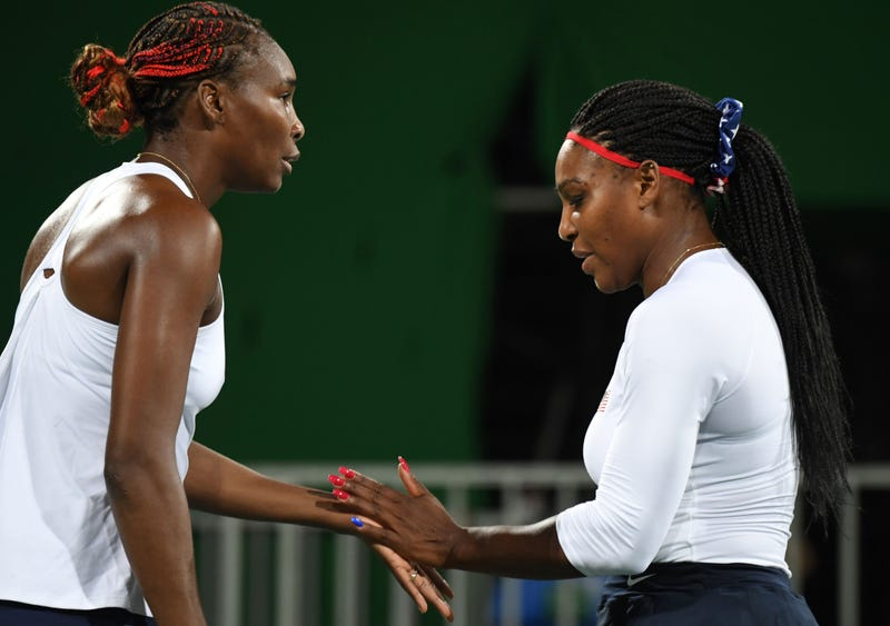 Venus Williams and Serena Williams at the 2016 Olympic Games in Rio de Janeiro on Aug. 7, 2016 MARTIN BERNETTI/AFP/Getty Images