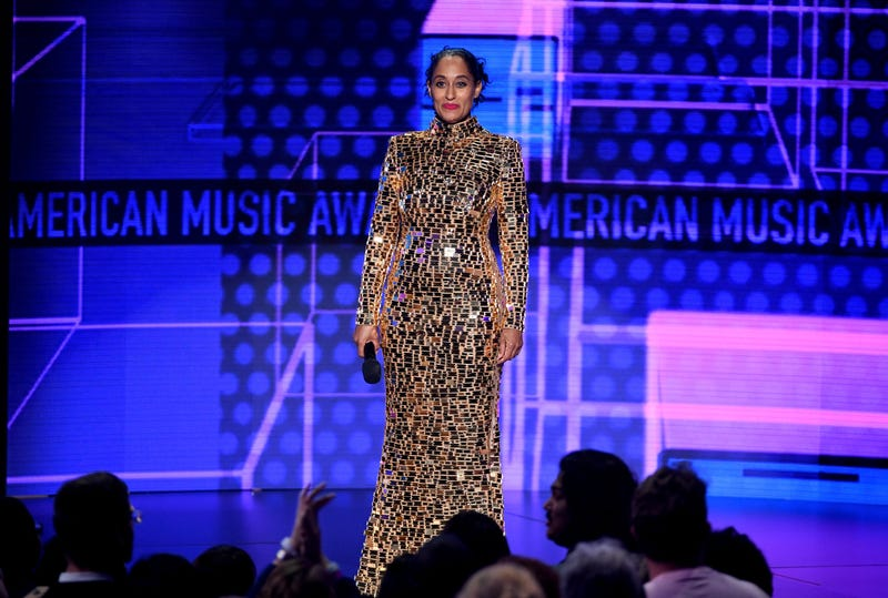 Tracee Ellis Ross wears a gold dress by CD Greene onstage during the 2018 American Music Awards at Microsoft Theater on October 9, 2018 in Los Angeles, California.