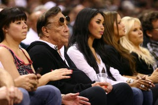 V. Stiviano (third from left) sits next to then-NBA team owner Donald Sterling while watching the San Antonio Spurs play the Memphis Grizzlies during the NBA Western Conference Finals in San Antonio May 19, 2013.Ronald Martinez/Getty Images