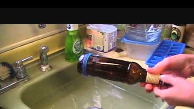 Cut a glass bottle using nail polish string and fire for Cutting glass bottles with string