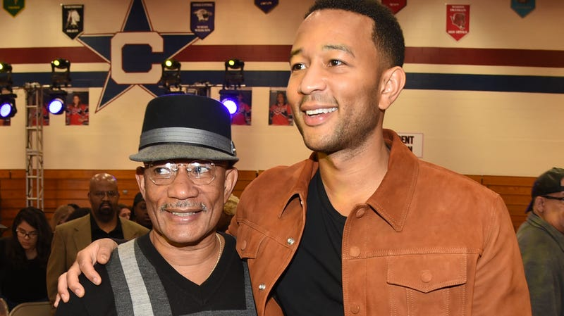 Performer John Legend and his father Ronald Stephens are seen at the AXE Senior Orientation on October 17, 2017, at Centennial High School, Columbus City Schools in Columbus, Ohio.