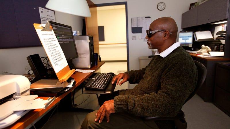 A blind veteran learns computer skills at the Edward Hines Jr. VA Hospital in Hines, Illinois.