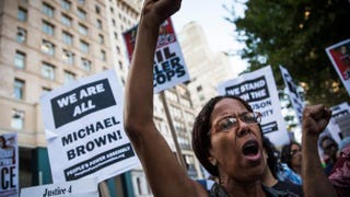 Protesters hold a rally in New York City Aug. 18, 2014, in solidarity with the people of Ferguson, Mo., protesting the death of Michael Brown and the excessive use of force by police. Andrew Burton/Getty Images