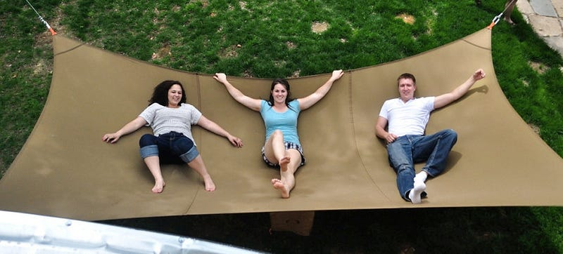 There'll never be another fight over who gets to lay in the hammock with  this monstrosity strung up in your backyard. The Mega Hammock requires you  to find ... - Your Entire Family Can Waste Away The Summer On This Mega Hammock