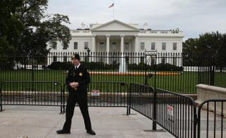 A uniformed member of the U.S. Secret Service stands guard in front of the White House Oct. 23, 2014, in Washington, D.C.Mark Wilson/Getty Images