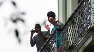 Jay Z and Beyoncé look out from a balcony of the Saratoga Hotel in Havana on April 5, 2013.STR/AFP/Getty Images