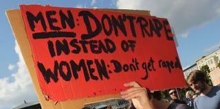 Anti-rape protest sign from 2011 (Sean Gallup/Getty Images)