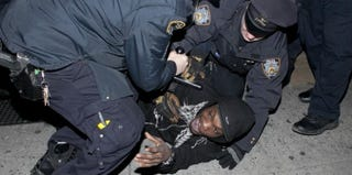 A man is arrested during protest of NYPD shooting of Kimani Gray, March 2013, in Brooklyn (Allison Joyce/Getty Images)