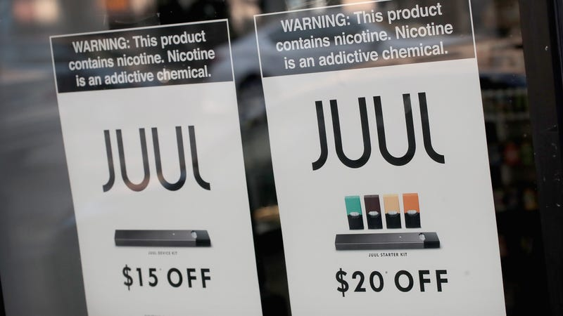 An advertisement for Juul's e-cigarette pods, including those flavored.