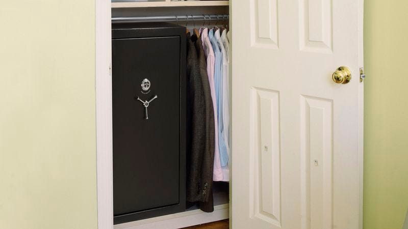 A child is locked inside a safe in a closet.