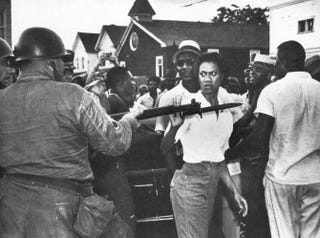 Gloria Richardson pushes away the bayonet of a National Guardsman during a protest in Cambridge, Md., in 1963.Wikipedia