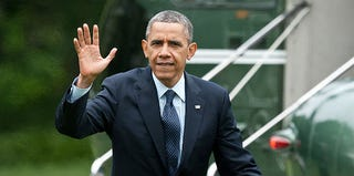 President Obama arrives at the White House on May 24, 2013. (NICHOLAS KAMM/AFP/Getty Images)