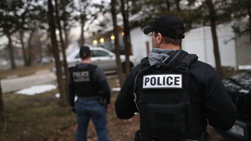 "Customs and Border Protection agents watch as Homeland Security Investigations agents detain an alleged MS-13 member in Brentwood, New York in March 2018 as part of ""Operation Matador."""