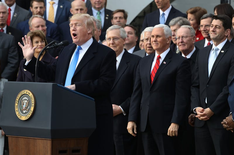President Donald Trump hosts an event to celebrate passage of the Tax Cuts and Jobs Act with Republican members of the House and Senate on the South Lawn of the White House in Washington, D.C., on Dec. 20, 2017. (Chip Somodevilla/Getty Images)