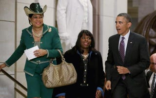 President Barack Obama leaves a meeting with members of the House Democratic Caucus March 14, 2013, in Washington, D.C. With the president are Reps. Frederica Wilson (Fla.) and Terri Sewell (Ala.). Chip Somodevilla/Getty Images