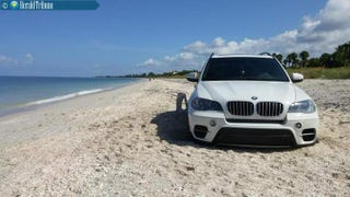 Illustration for article titled I Know You Guys Love This: BMW Gets Stuck Driving On Beach