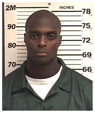 Illustration for article titled And Now, Your Official Plaxico Burress Mug Shot
