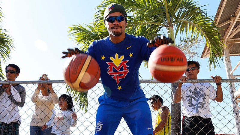 Pacquiao, playing with two balls.