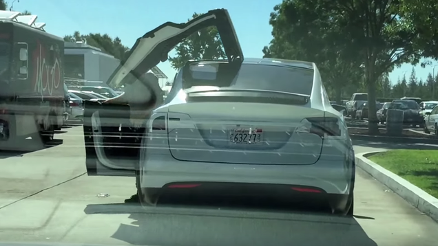 Watch the new tesla model x doors in action outside of the showroom