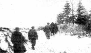 Illustration for article titled Unseen Photos From The Battle Of The Bulge Found In Foxhole [Updated]