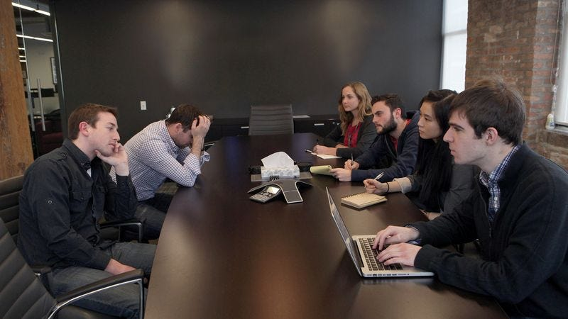 The recent intern group at Kapper Media eagerly listens as some of the company's completely exhausted and unhappy employees answer their questions.