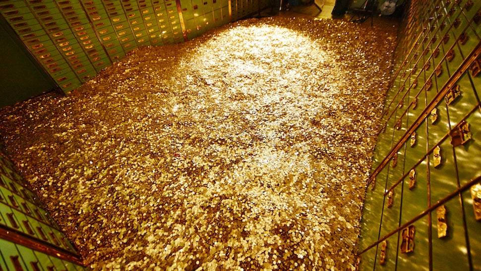 holy wow you can actually swim like scrooge mcduck in this bank vault rh gizmodo com room gold coast room gold and white