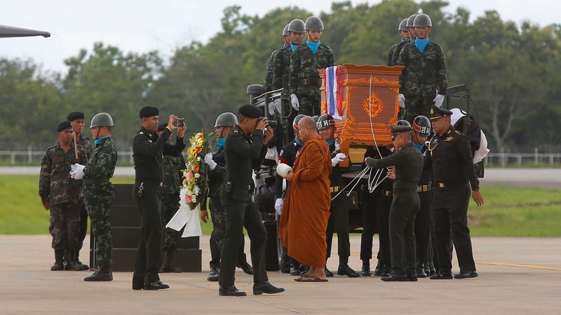 The body of Saman Gunan is carried during a repatriation and religious rites ceremony at Chiang Rai Airport in Mae Sai, Chiang Rai province, in northern Thailand Friday, July 6, 2018.