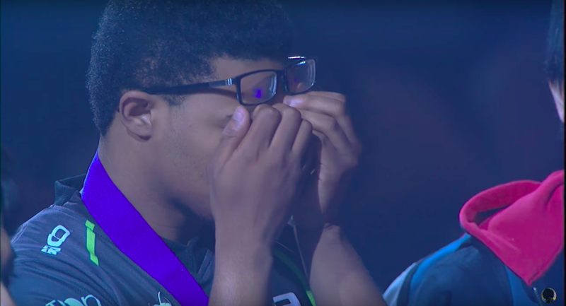 Punk putting his head in his hands after receiving his second-place medal in Street Fighter V at Evo 2017 (via YouTube)