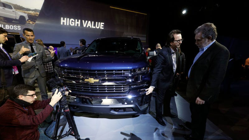 Members of the news media examine the new 2019 Chevrolet Silverado 1500 at its official debut at the 2018 North American International Auto Show January 13, 2018 in Detroit, Michigan.