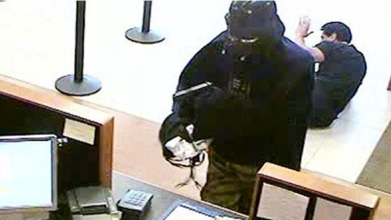 Illustration for article titled Darth Vader robs a Long Island bank that was unwise to lower its defenses