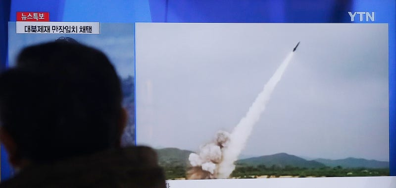 Watching the North Korean launch on South Korean TV (Image by AP)