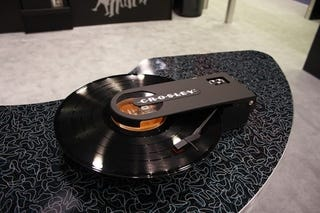 Illustration for article titled Crosley Revolution Portable Turntable Brings Vinyl on the Road
