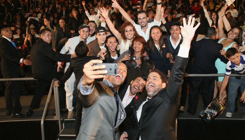 Illustration for article titled For Your Captioning Pleasure: The Rock Takes a Selfie with Fans